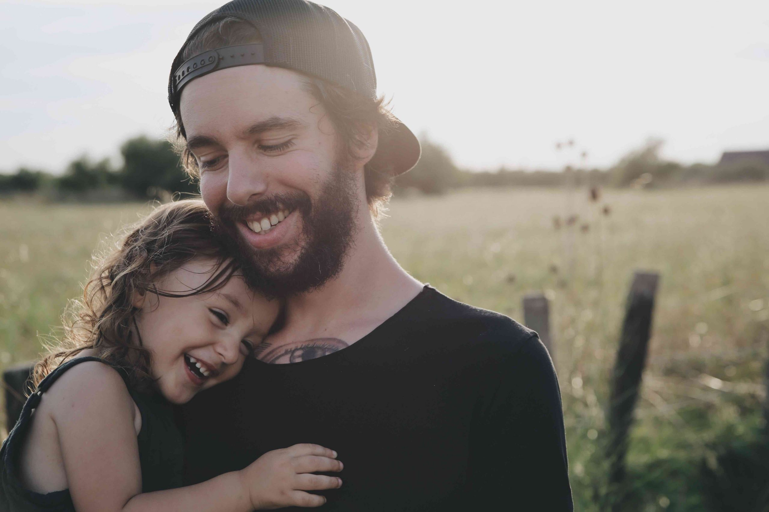 dad holding his daughter