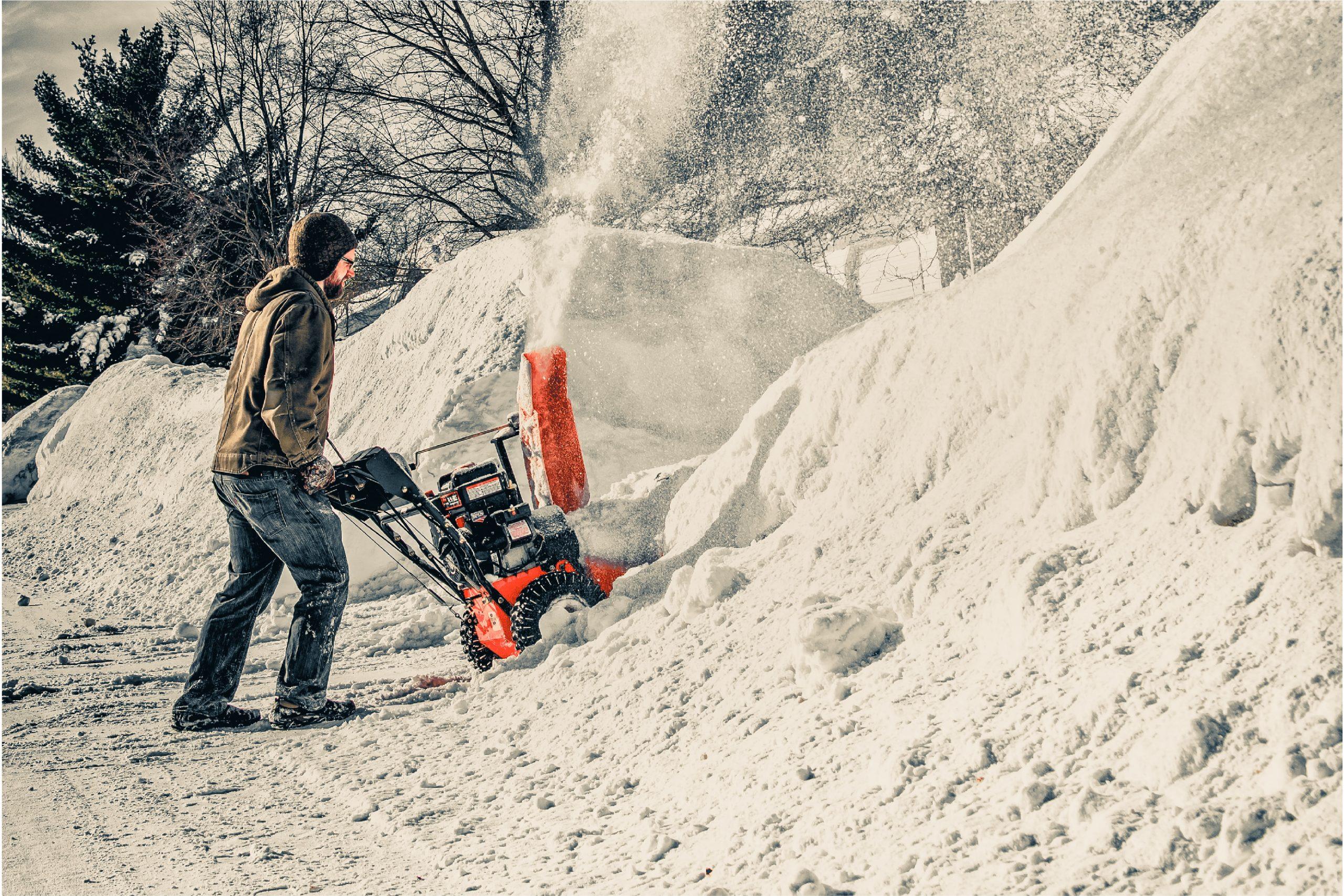 guy plowing snow